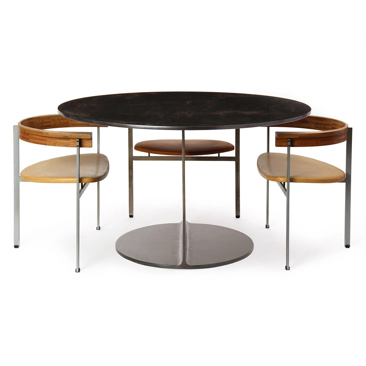 An I-Beam 'Gong' table of great weight and stability, crafted of cut, welded and blackened steel. The Gong tabel is made to order and takes 4-8 weeks to produce. Available in steel, stainless steel and bronze in brushed, satin, polished or blackened