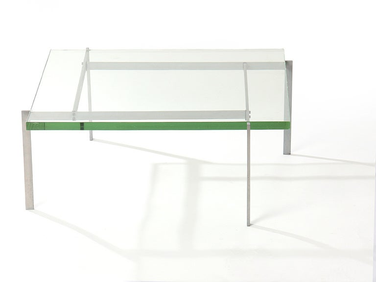 "A low table with a satin-chrome steel frame with an original 1.25"" glass top."
