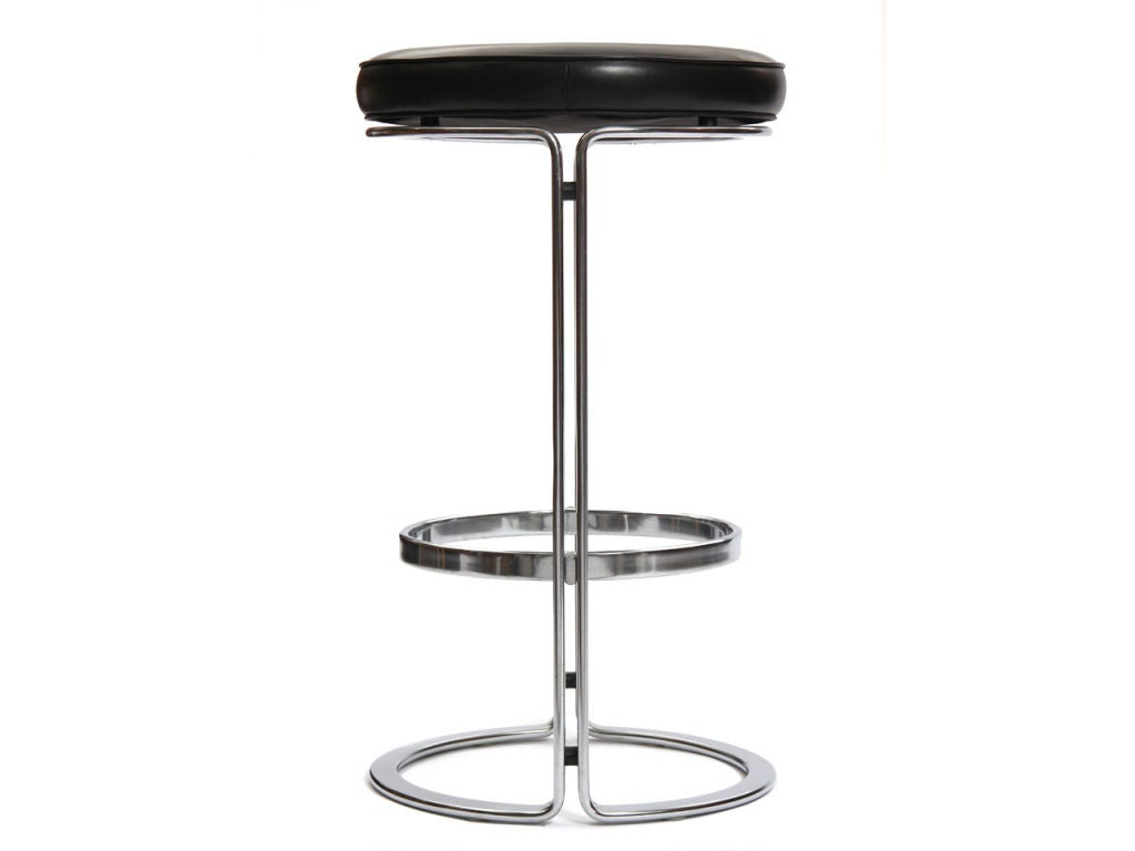 A pair of split beam steel bar stools with black leather seats.