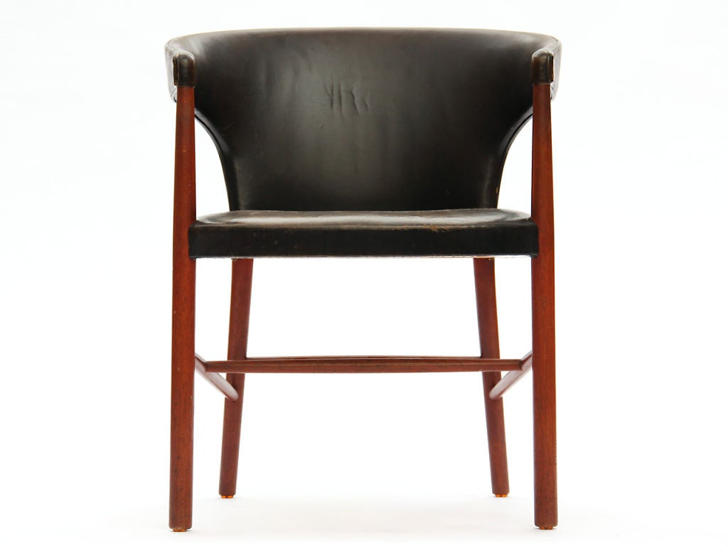 A B-48 armchair designed by Jacob Kjaer in teak wood with original black leather. Crafted in Denmark circa 1940s.