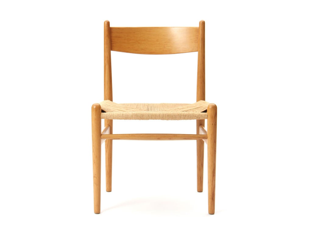 An oak side chair with papercord woven seat.