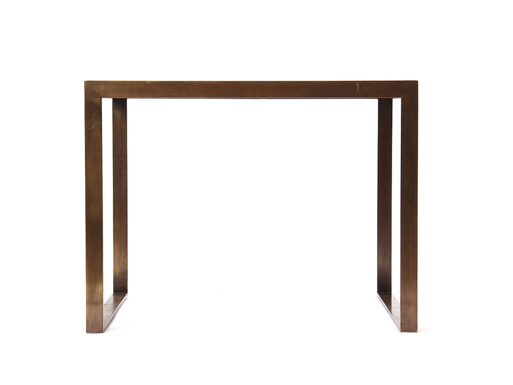 A patinated brass flat-bar framed end table with an inset rosewood top.