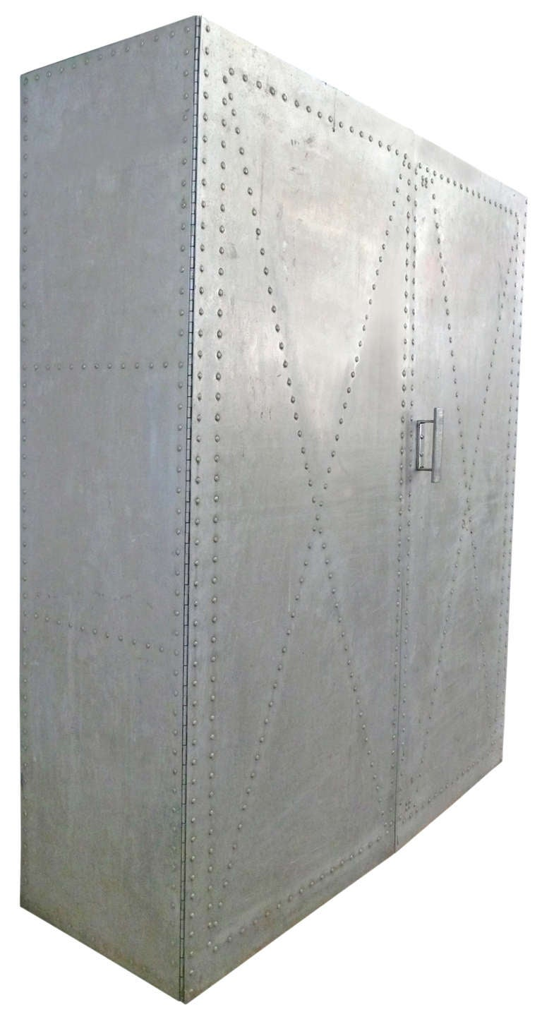 A fantastic and unique, hand-made riveted aluminum storage cabinet with extremely decorative