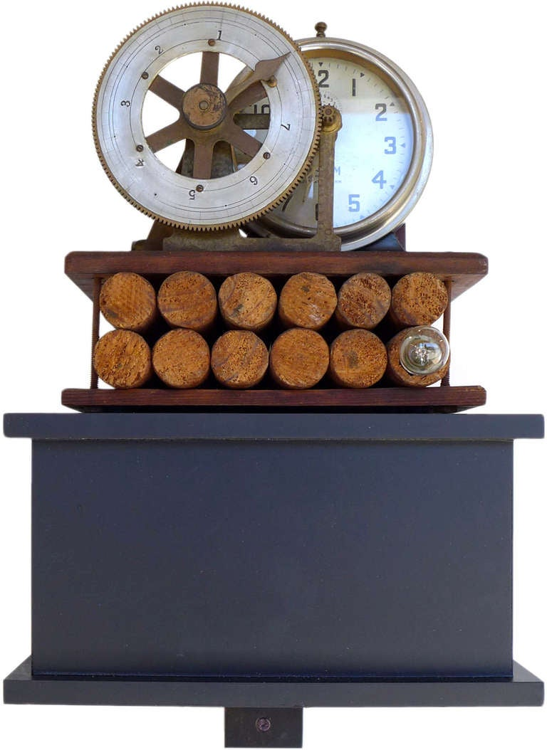 "A wonderful folk art ""time-bomb"" constructed from an old alarm clock and other found materials. Beautifully and artistically executed and wired to light up upon ""explosion"". Carved wooden dowels represent dynamite sticks and the whole composition of"