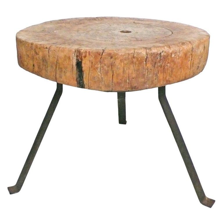 Massive wood and steel chopping block table at stdibs