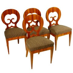 An exceptional suite of Four Biedermeier Side Chairs