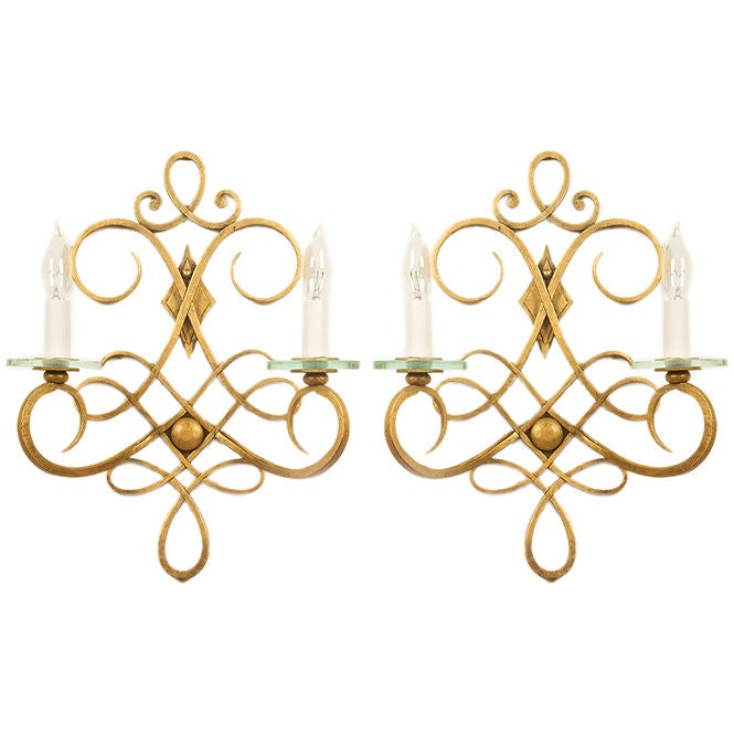 A pair of French 40's forged iron wall sconces