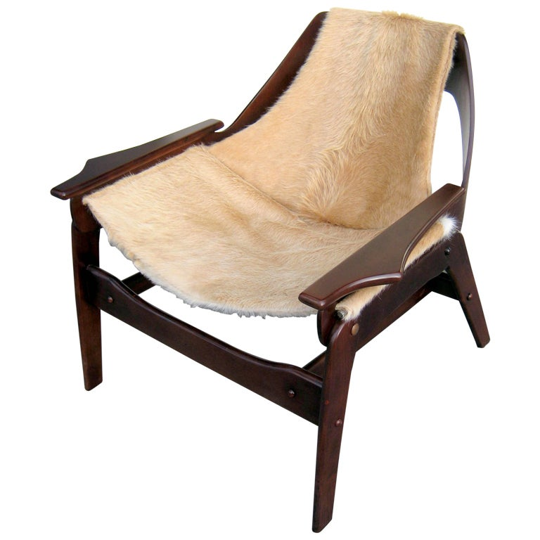 A Stained Walnut Sling Chair Designed By Jerry Johnson In