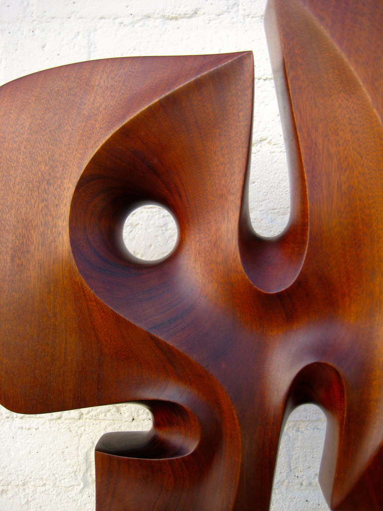 A Seductively Carved 1970 S Mahogany Sculpture On Travertine Base At 1stdibs
