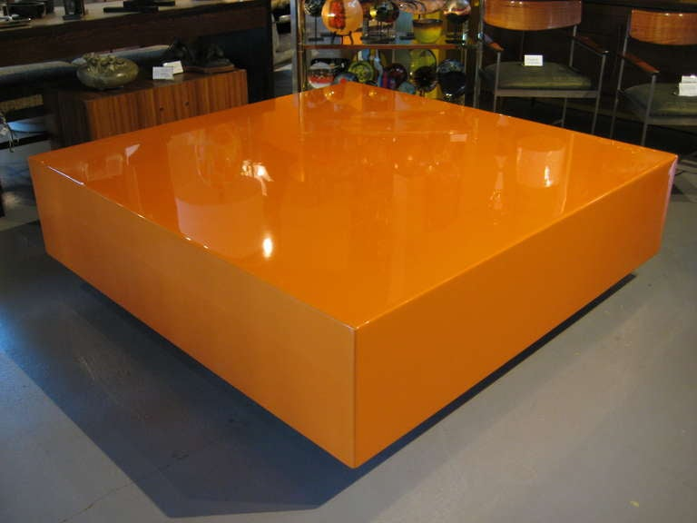 A Superb Large Scale Autobody Lacquered Hermes Orange Coffee Table On A Recessed Acrylic Base At