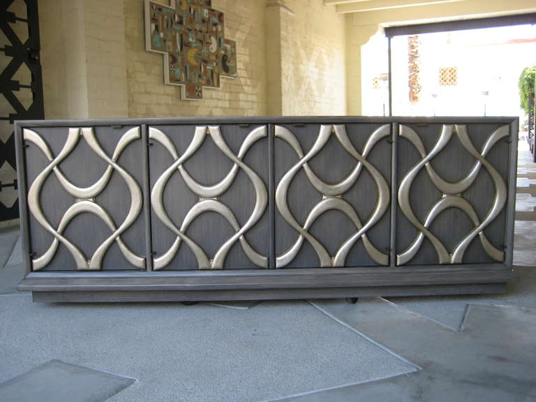 A 1970s Sculpted Facade Silver Leaf Credenza By American