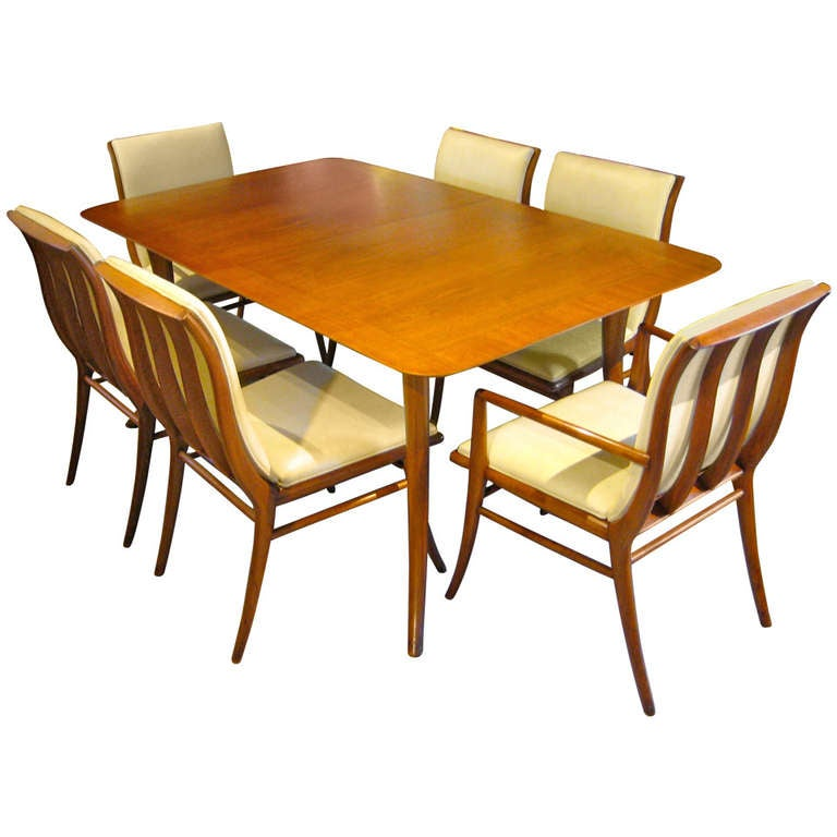 Rare set of six saber leg chairs and dining table by t h for Dining room table and 6 chairs