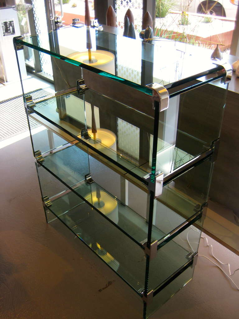 A Sleek Glass And Chrome Low Etagere Designed By Leon
