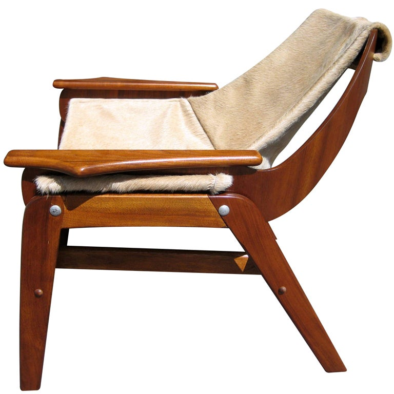 A walnut sling chair designed by Jerry Johnson in 1964
