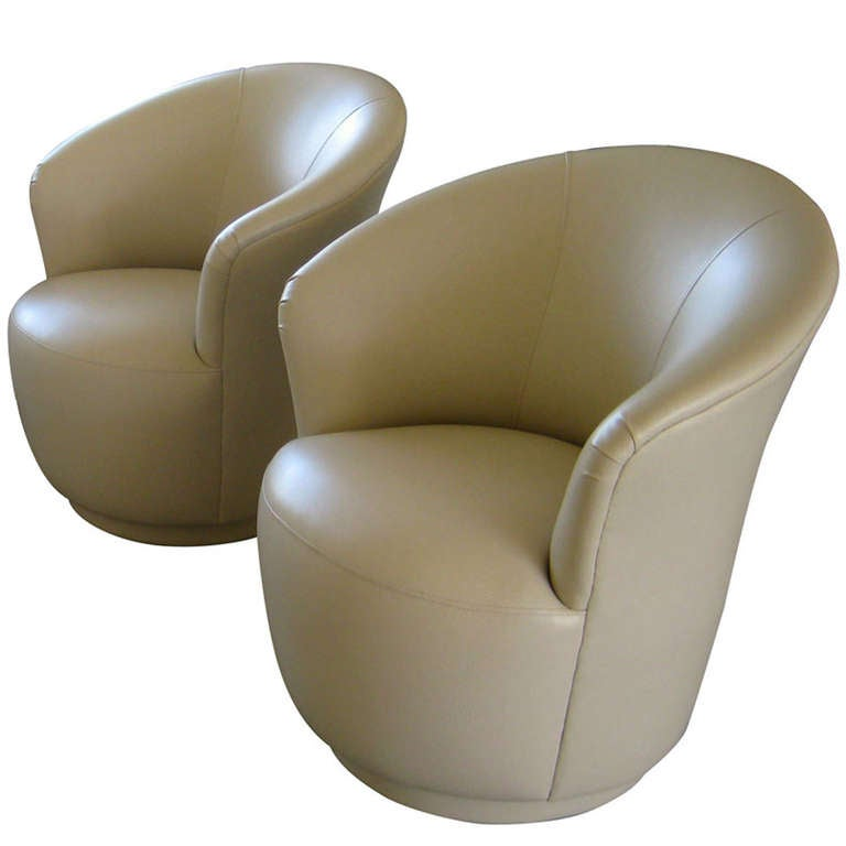 Pair Of Swiveling Club Chairs In The Manner Of Karl