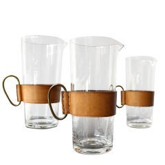 Two Carl Aubock Glass , Leather & Brass Pitchers