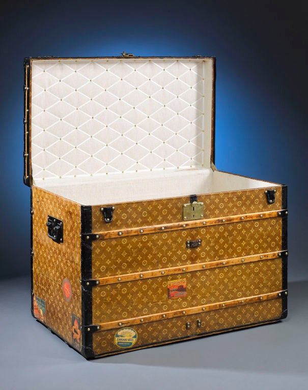This captivating antique Louis Vuitton trunk exemplifies the style and grace of the golden age of travel. This flat-top steamer case is covered with the familiar LV monogram on an early light brown handwoven canvas, and is finished with all original