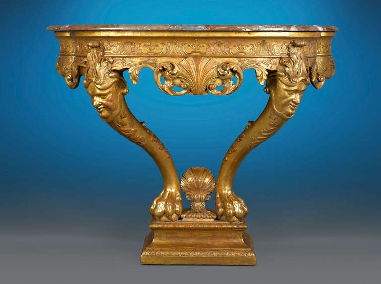 This captivating George I gilt-wood and gilt-gesso console table exhibits magnificent style and artistry in the manner of the renowned William Kent. A work of masterful detailing and balance, this table boasts the Rococo-inspired Palladian style