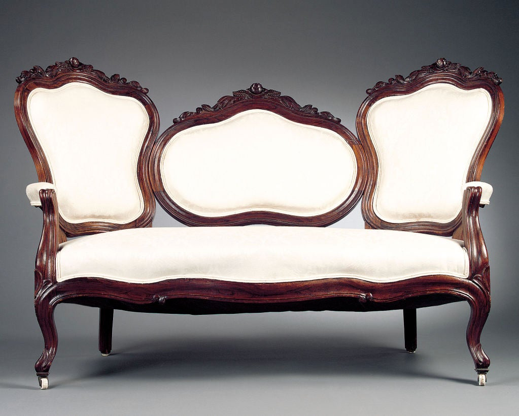 A Nicely Carved American Victorian Mahogany Medallion Back Sofa With  Serpentine Front And Cabriole Legs.