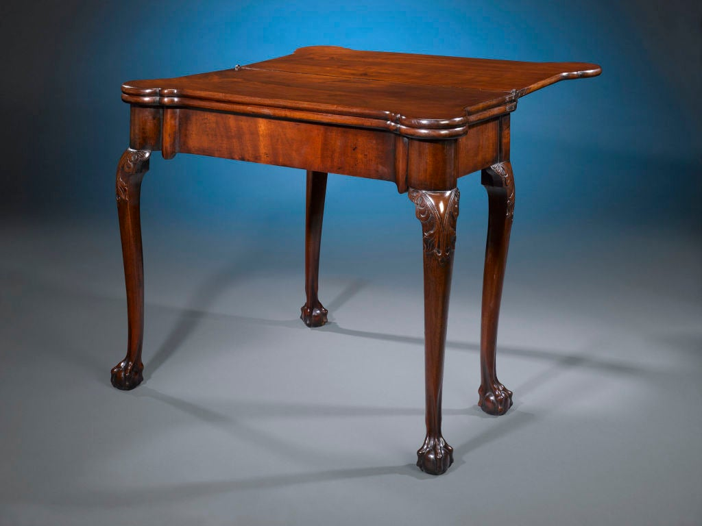 There is more than meets the eye with this exceptional George III-period table. Crafted of luxurious mahogany and aged to a rich patina, this table opens to reveal not one, but two different surfaces. Lift the first top to use the table as a tea