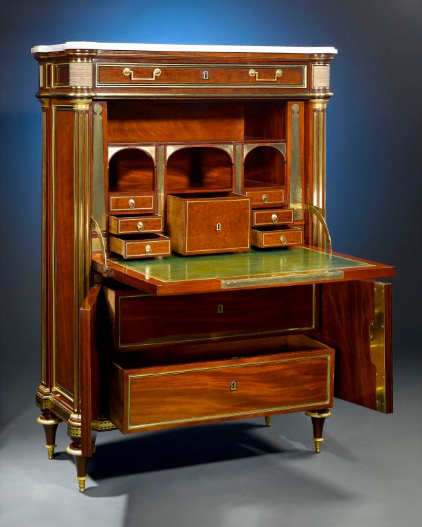 This most extraordinary secrétaire à abattant by Bernard Molitor displays superb proportion and balance. Beautifully crafted of mahogany with ormolu mounts and accented by a fine white marble top, the secrétaire features a fall-front that opens