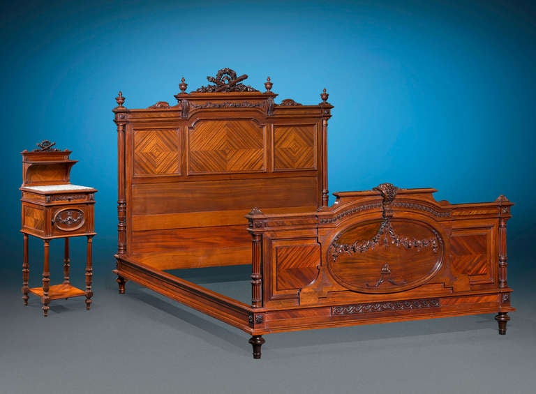 This exceptionally rare double bed by Mercier Frères is beautifully carved in the elegant Louis XVI style. Crafted from luxurious mahogany, the bed displays highly detailed Neoclassical carving at the head and foot complemented by striking parquet