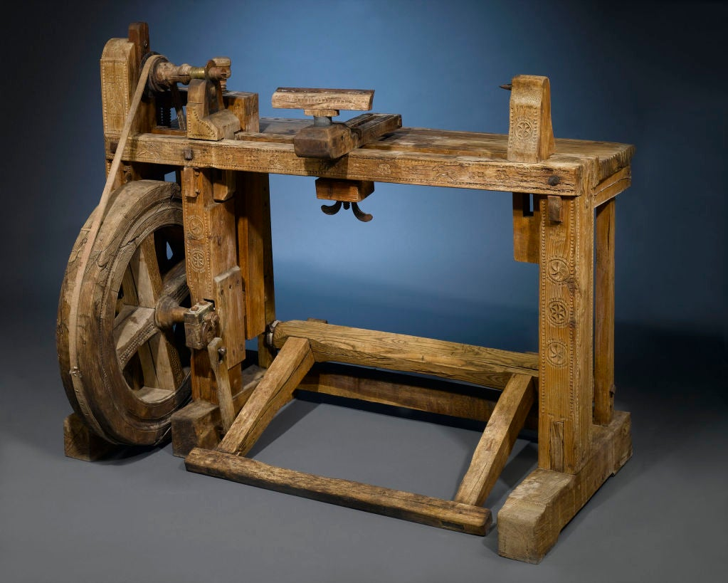 A highly important tool in the creation of furniture, this 19th-century French woodworker's lathe is itself an object of beauty. A remarkable piece of machinery, it is set in motion by the large foot treadle, which turns the larger wheel. This wheel