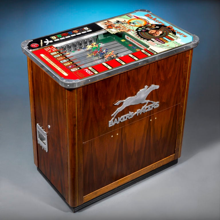 "An extraordinary Baker's Pacers coin-operated horse racing machine produced by the Baker Novelty and Manufacturing Company of Chicago. Known as a ""long case"" model, this elegant machine allows a customer to place nickel bets on up to seven"