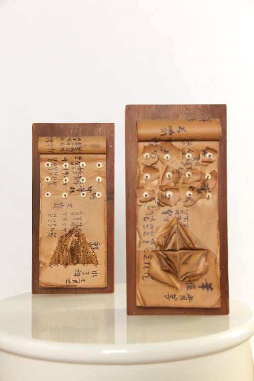 Beautifully inscripted Asian writing on paper pads (similar in color to papyrus), each page with inscription on front and back, set on heavy wooden blocks with accent nails piercing through ivory-colored discs. Ready for hanging.