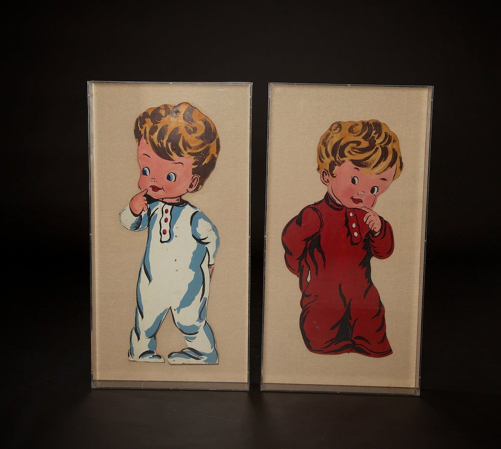 Pop art created in the 1970s, using the original cut-out from 1940s fiberboard advertising signs from a children's clothing company. This charming pair are each set in plexiglass with a nice depth. We think that the flaps in back show advertising