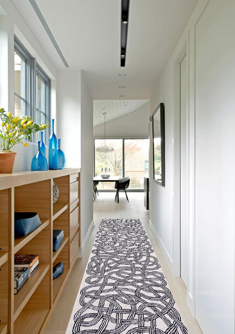 This Classic, black and white hand-tufted wool runner by Anni Albers is adapted from a 1959 runner design and limited to only 150. The piece features an enticing lattice of loosely woven laces.    Anni Albers runner Hand-tufted wool Measures: