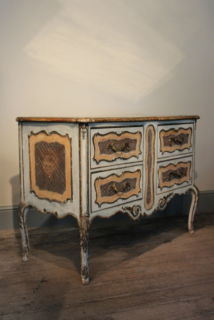A very elegant, circa 1950s Italian commode in the 18th century taste, retaining the original pale paint and gilding and the original mirrored top. This painted commode will maker a statement in most settings. Italy Circa 1950.