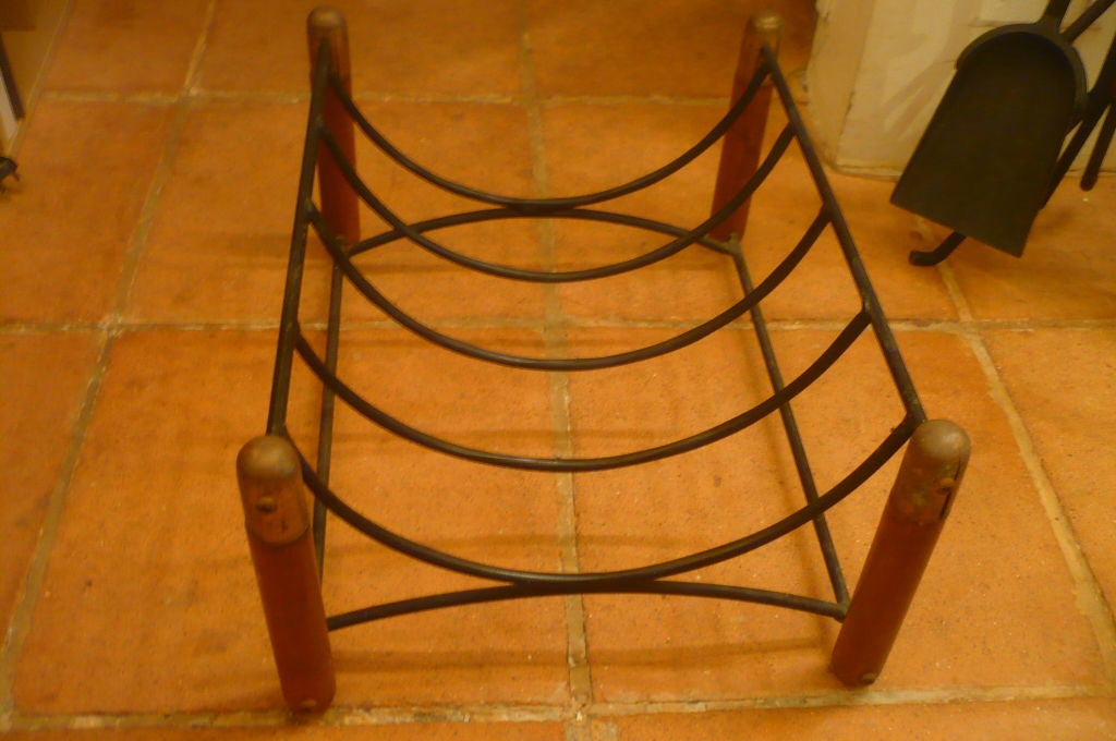 Vintage 1950s solid wood, iron and brass log holder.