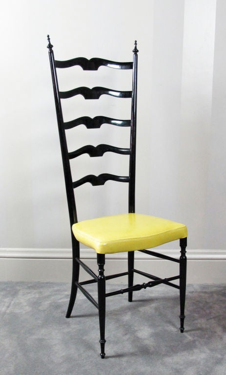 A very beautiful Chiavari chair in the style of Gio Ponti.  Original black lacquer finish.  Newly upholstered in a glazed chartreuse leather by Cortina.