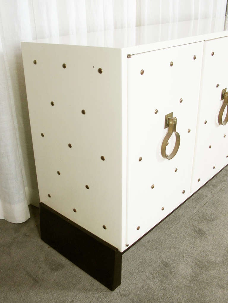 Mid-Century Modern Studded Sideboard by Tommi Parzinger For Sale