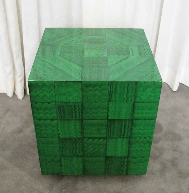 This is a very well-made and highly decorative cube in faux malachite. Seemingly hand-painted, the malachite technique is tiled to dramatic effect. The cube shape is mounted on an ebonized wood plinth. Although the faux malachite technique is