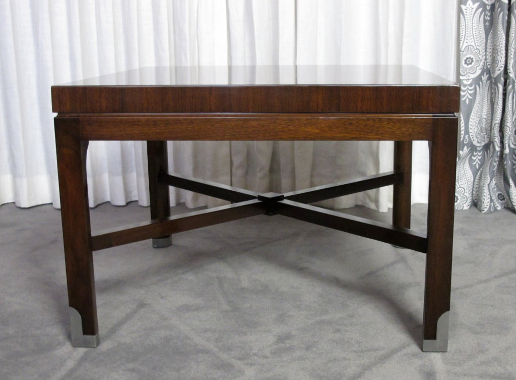 This is a beautiful mahogany cocktail or side table designed by the 20th century master, Tommi Parzinger.  This is an early Parzinger Originals piece that was executed by the workshop, Piano.  Piano did all Parzinger's work that incorporated poured