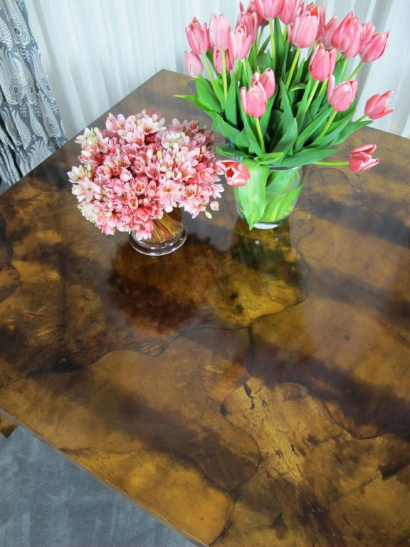 Handsome parchment table believed to be by Aldo Tura of Italy, but has no markings. Beautifully crafted and heavy. As this table has a solid top (was designed without leaves), it would also serve nicely as a large desk or writing table.