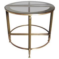 A Pair of Brass Demi Lune Tables