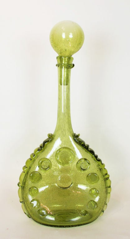 A wonderful large decanter by the French glass company Biot. The manufacturer's name is molded into two of the applied medallions. The decanter, which stands almost two feet high, is a gorgeous apple green.