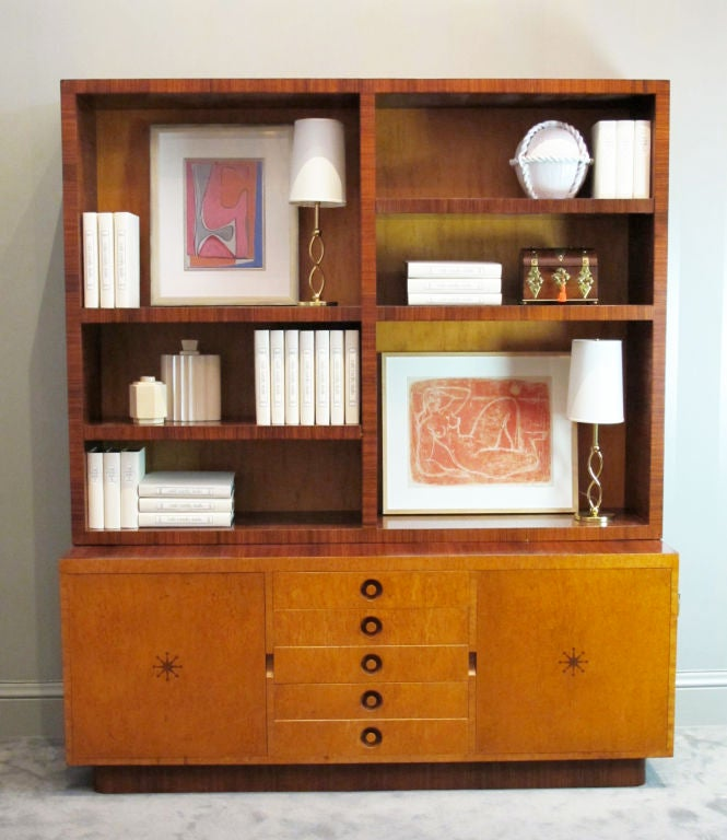 A big, beautiful bookcase designed by Andrew Szoeke with signature marquetry starburst. Open shelving unit is divided into four permanent cubbies, each with an adjustable shelf. A 32-inch flat screen television fits perfectly into the compartments