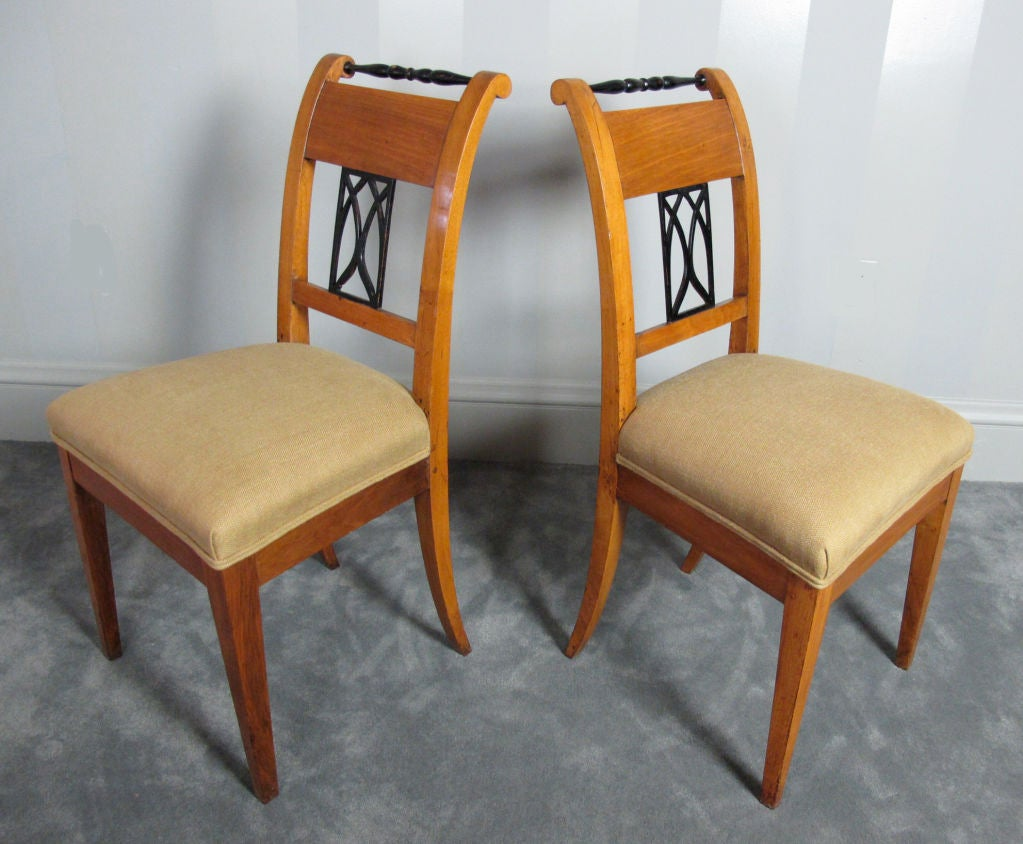 A very stylish pair of fruitwood Biedermeier chairs.  Most likely of Austrian origin.  Reupholstered in 15-ounce Belgian linen.  Priced as pair.