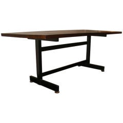 A Jules Wabbes Dinning Table With A Bronze Finish