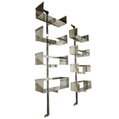 A Pair Of Chrome-plated Steel Shelving Units By Vittorio Introini