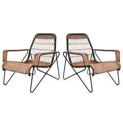 Pair of armchairs by Raoul Guy