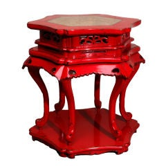 A Chinese Red Lacquer Hexagonal Table with Stone Inset Top