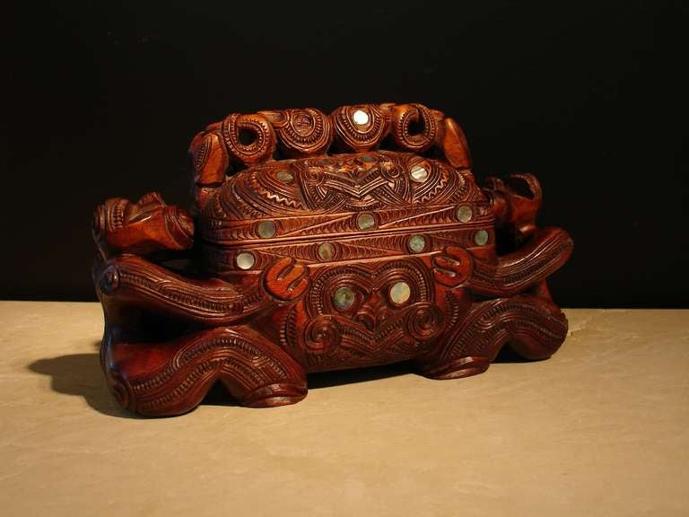A powerfully carved Maori Revival feather or treasure box.