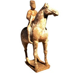 A Tang Dynasty Pottery Model of a Horse and Noble Rider