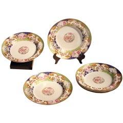 """A Set of Six  Famille Rose """"Pompadour"""" Soup Plates"""