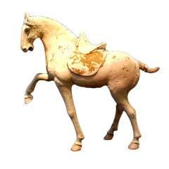 A Tang Dynasty Pottery Prancing Horse